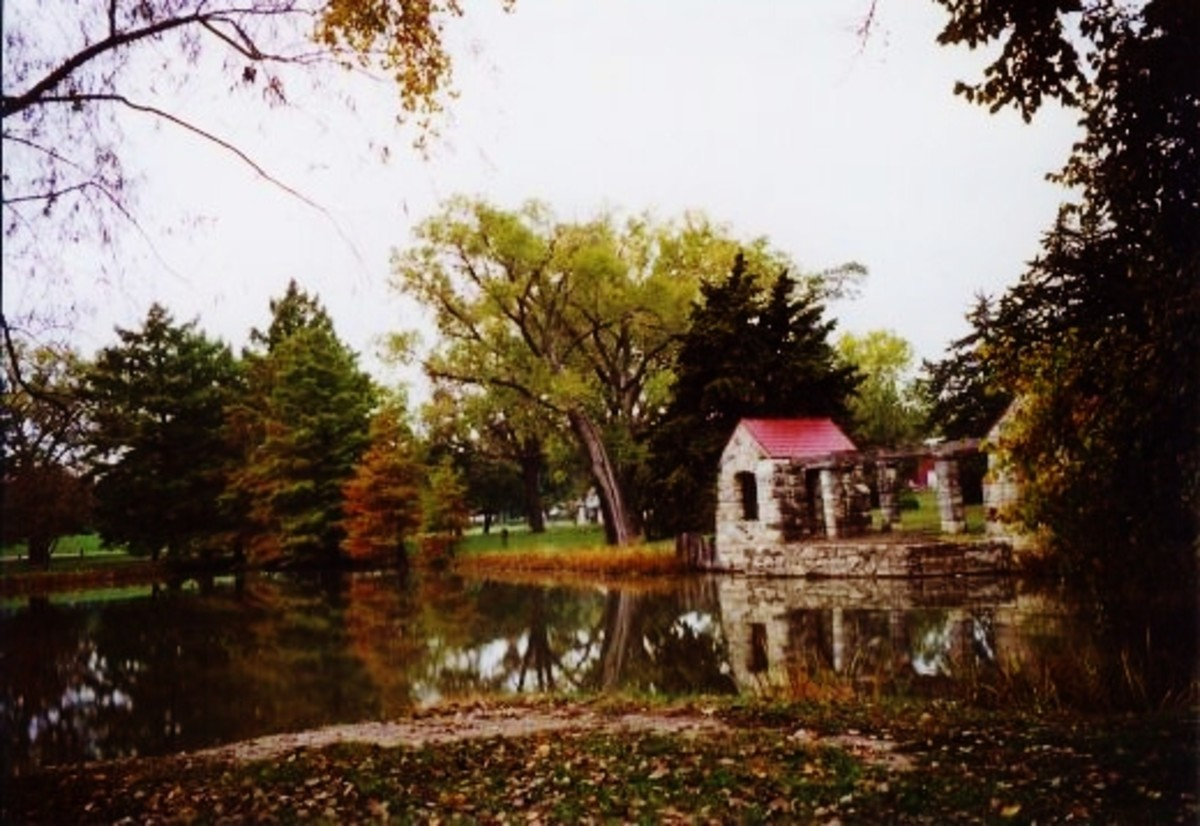 Colorful Fall reflections in the Peter Pan Park lake in Emporia, Kansas.