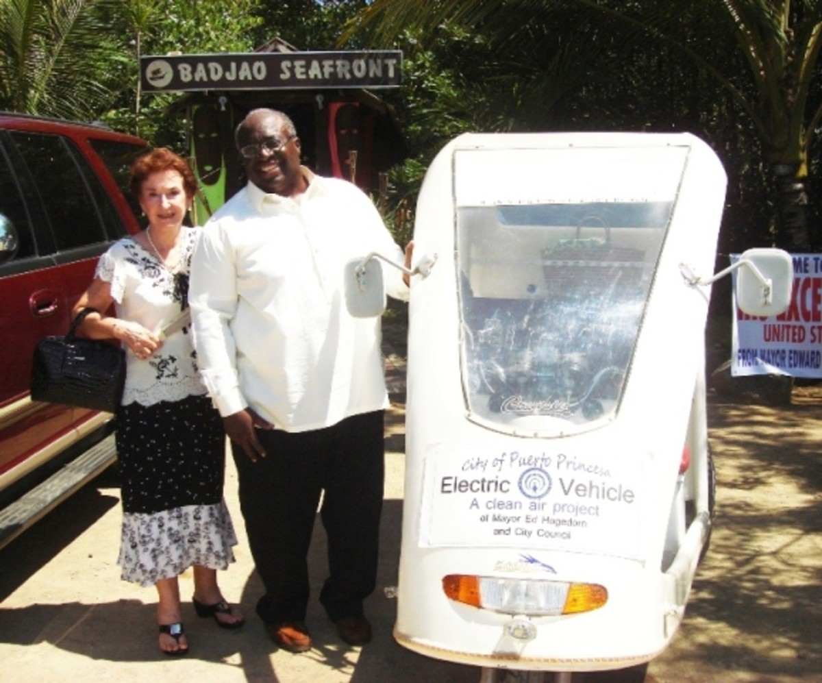 Helen Limjoco wth US Ambassador Harry K Thomas, Jr., at Badjao Seafront Restaurant in Puerto Princesa Palawan with our electric Tricycles.