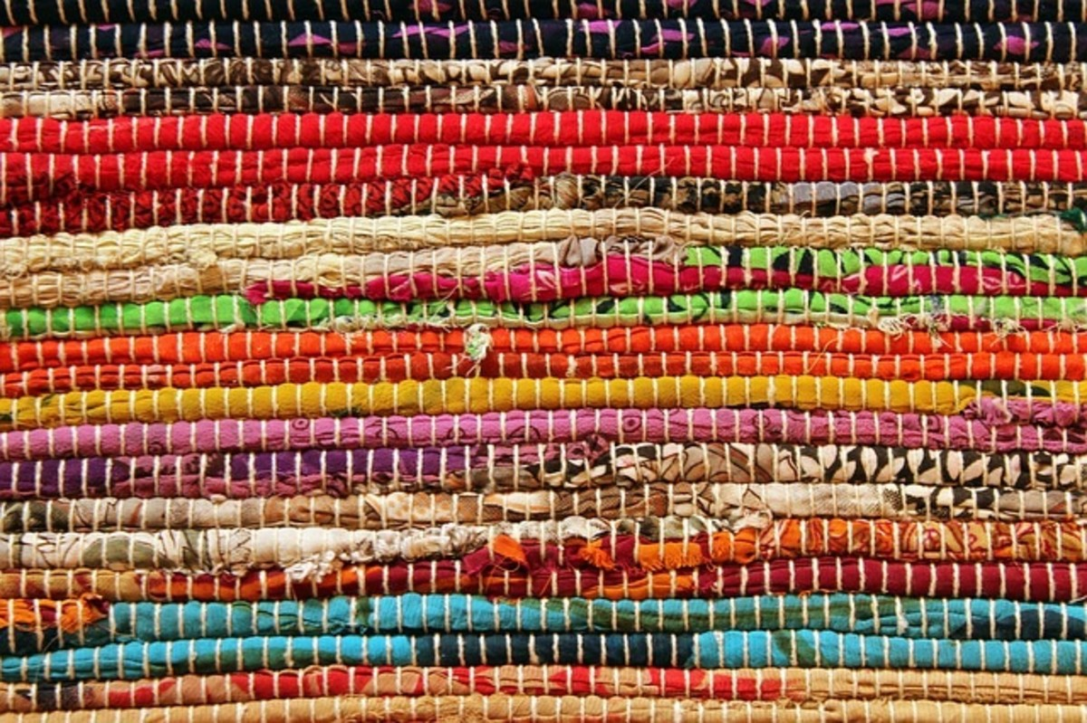 A rag area rug made from different pieces of old or discarded clothes.