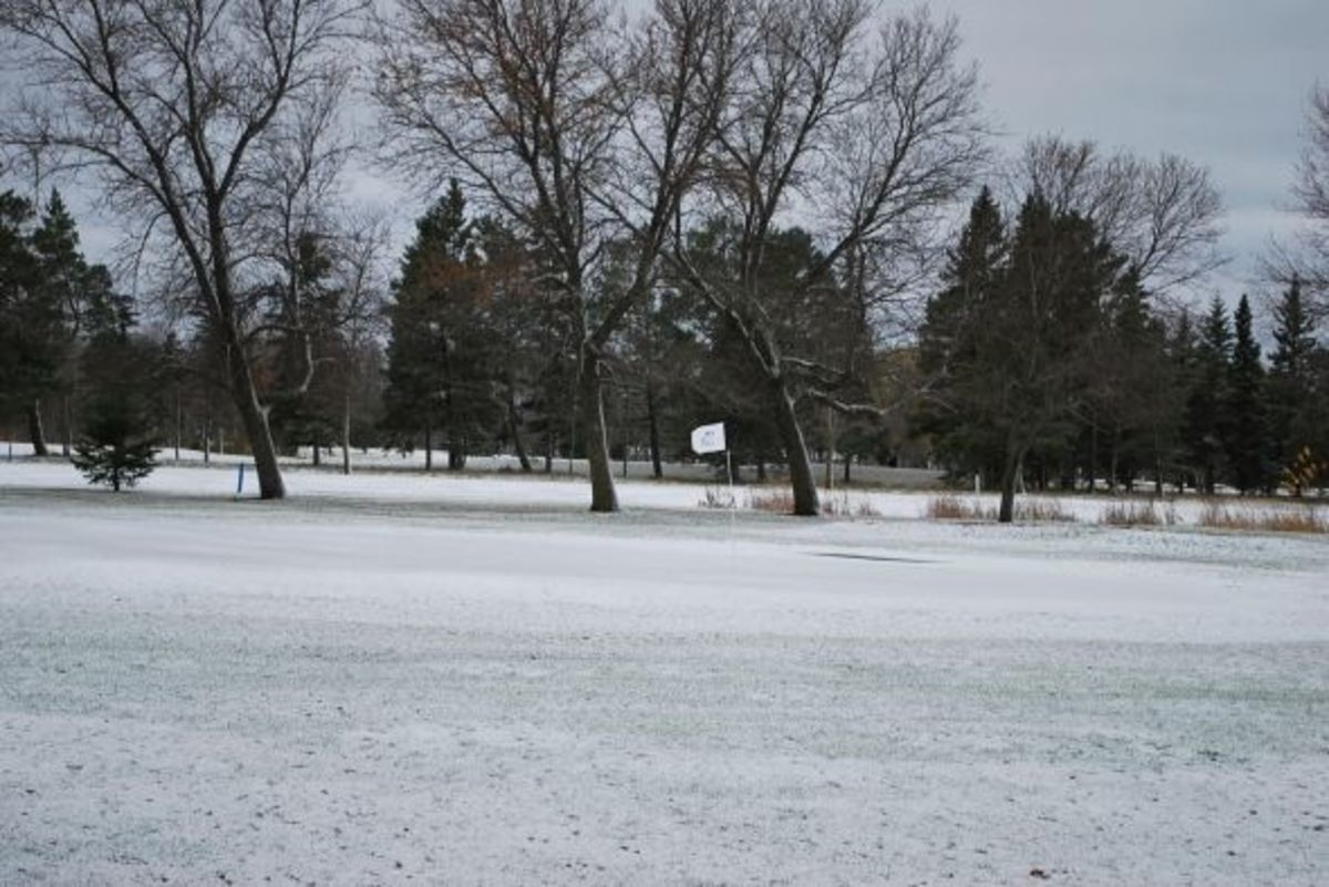 The first snow of the season, ironically, the pins were still in the greens at our local golf course.