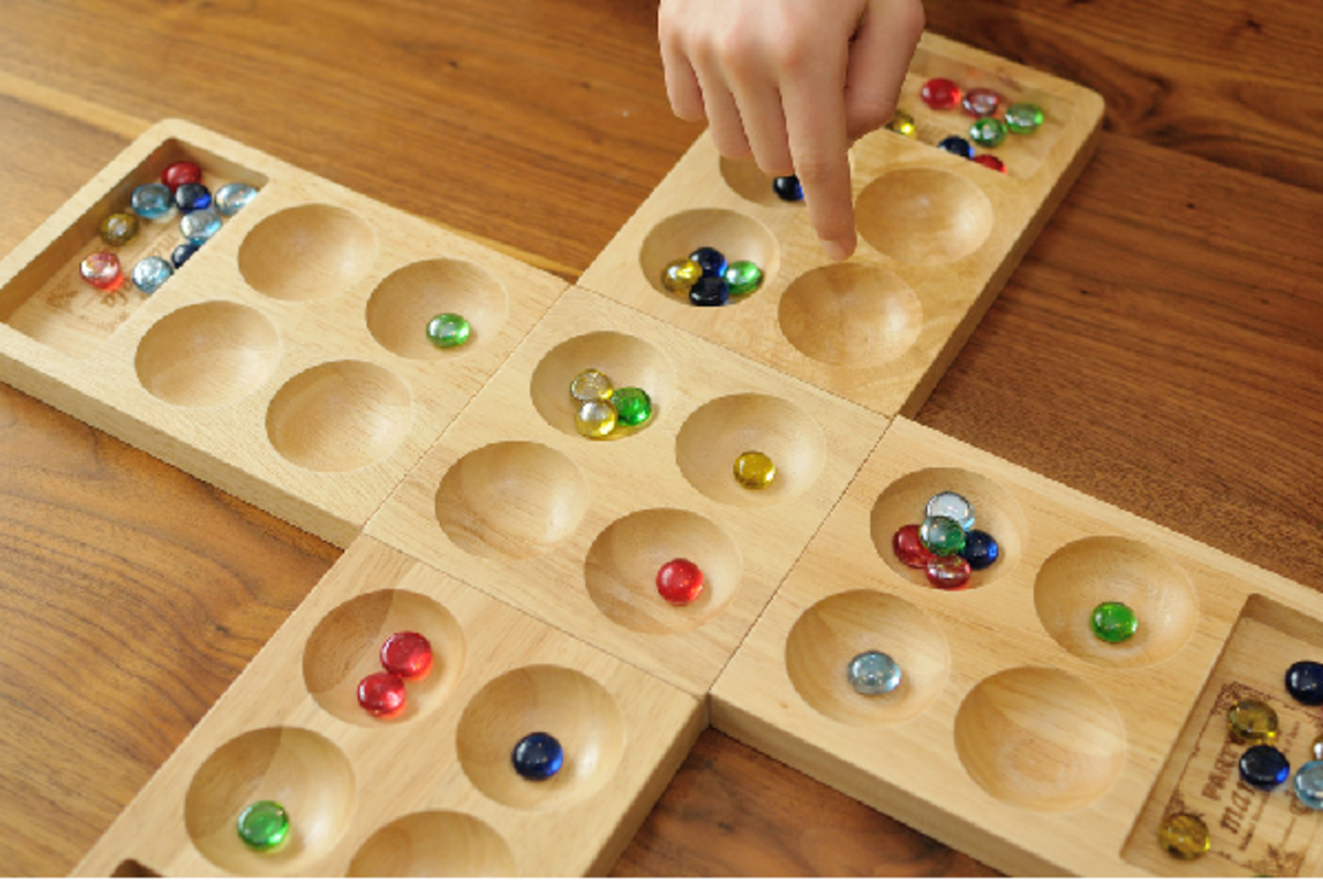 Modern 4 rank mancala board game made from engineered wood. A 4-player genre of the game.