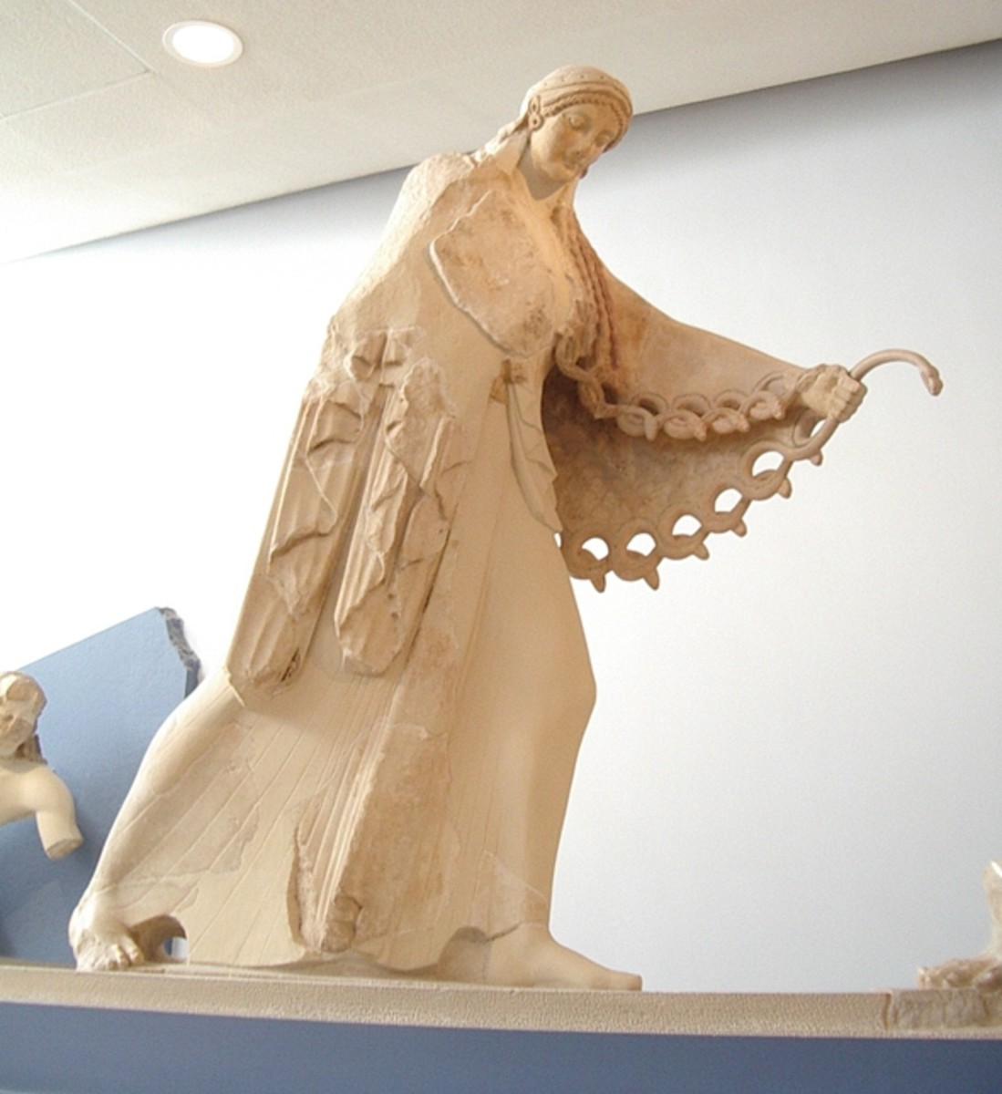 Archaic statue of the goddess Athena from pediment of her old temple, Acropolis Museum, Athens