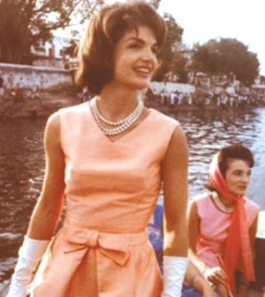 Jackie Kennedy wearing a three strand pearl necklace