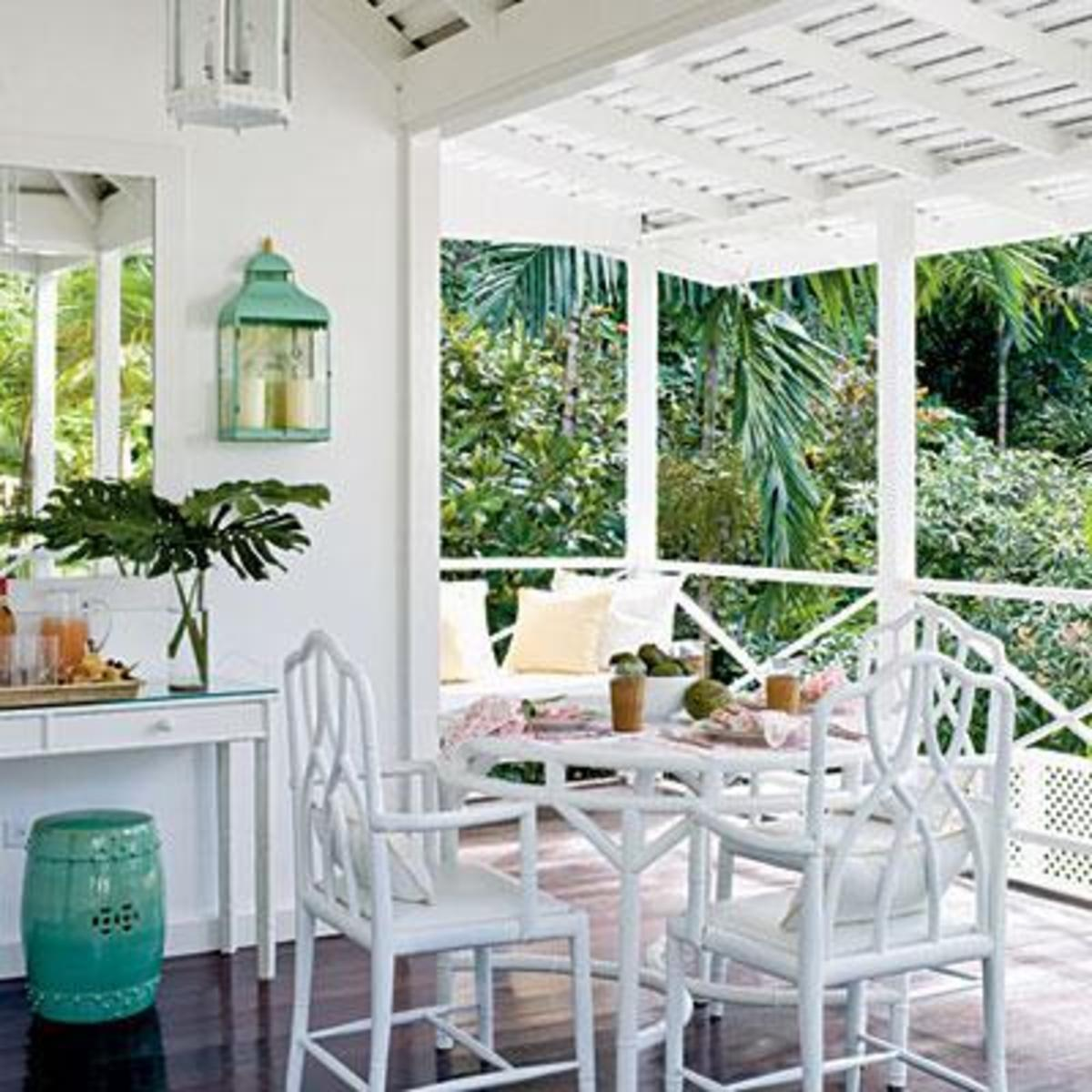 Beautiful Lanais with white table and chairs and painted wood beam ceiling accented with turquoise