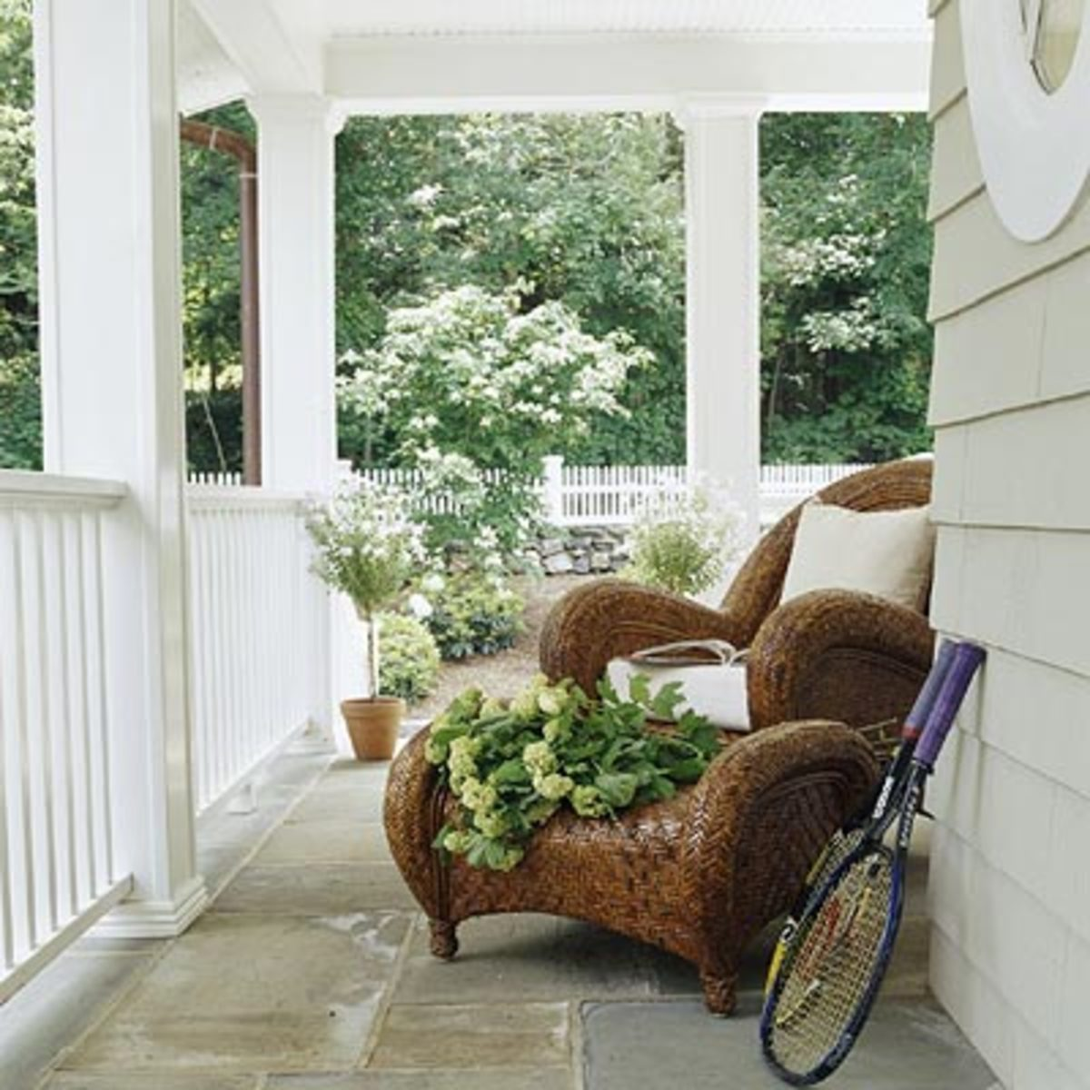 beautiful porch with two comfortable wicker chairs
