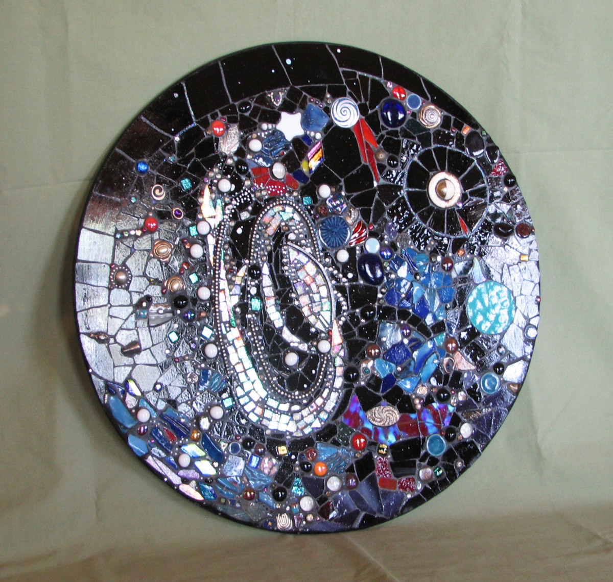 Mosaic wall art, two feet in diameter, stained glass, dichroic glass, semi-precious gems, vintage costume jewelry (sold)