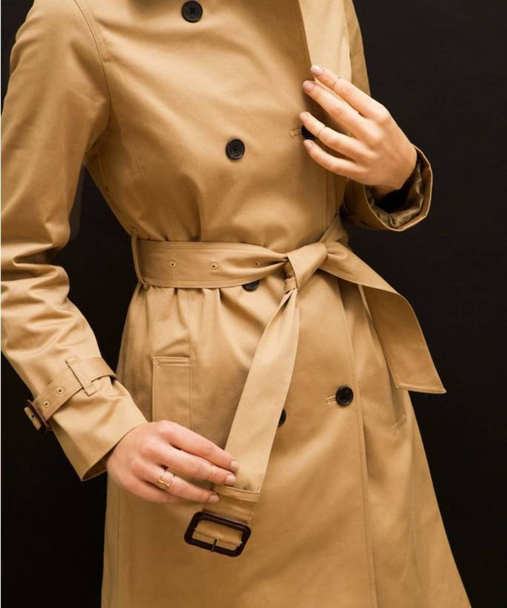 A trench coat is perfect for inclement weather and is completely stylish.