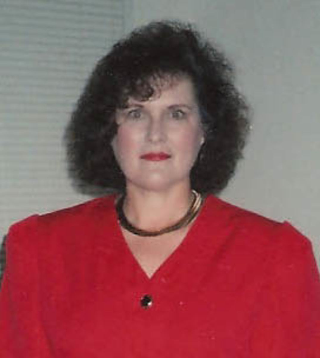 "The Dallas days--big hair and big shoulder pads, age about 47. I also wore ""enhanced"" nails."