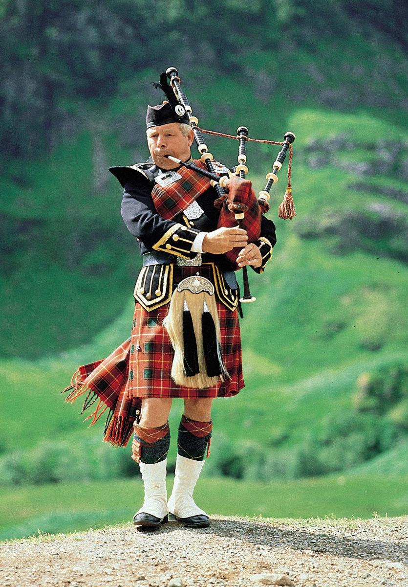 a bagpiper in full Scottish Highland dress