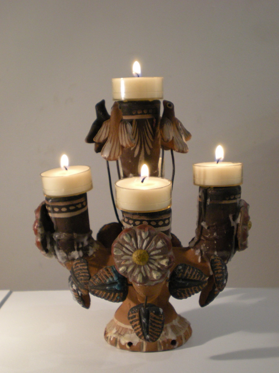 Ceiba del Mar from Mexico.  Fire represents spiritual spark that animates the clay of material forms.