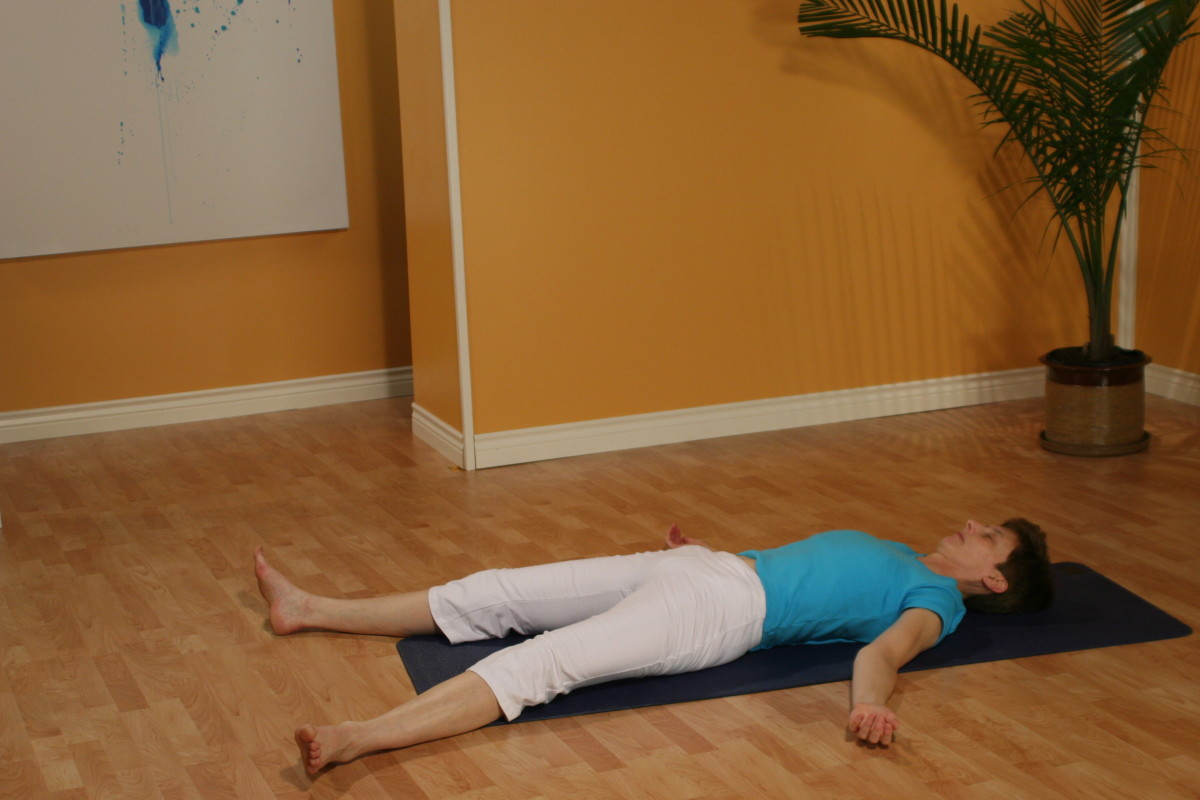 Relaxation position, or savasana, for conscious relaxation and Antar Mouna meditation techniques.