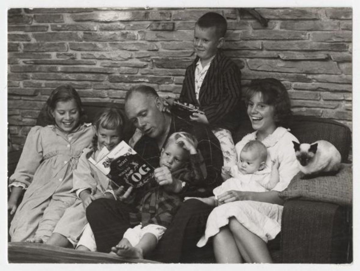 Pierre Berton and family reading The Secret World of Og in 1961