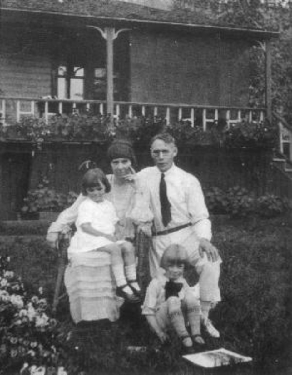 The Berton family at home in Dawson in the 1920s. That's young Pierre on the ground with the Prince Valiant haircut. The photo is from volume one of his autobiography, Starting Out.