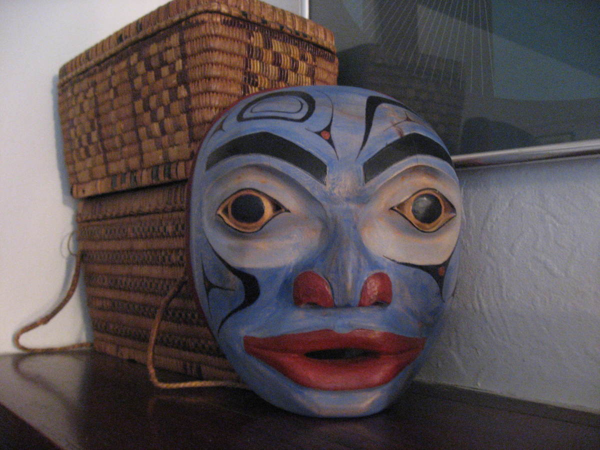 My second mask carved down and redone with background of old first nations cedar baskets