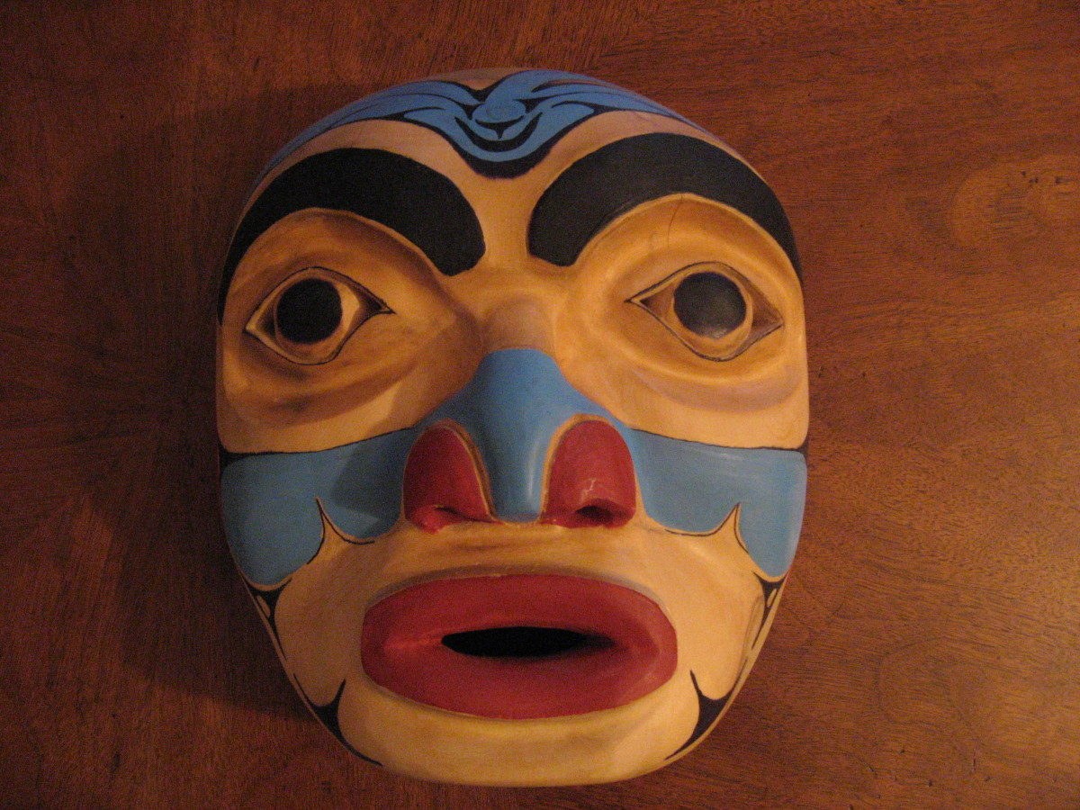 "My second mask carved from a yellow cedar log which I found on the beach. I tried to follow instructions from the book ""Carving Totempoles and Masks"" and didn't succeed."