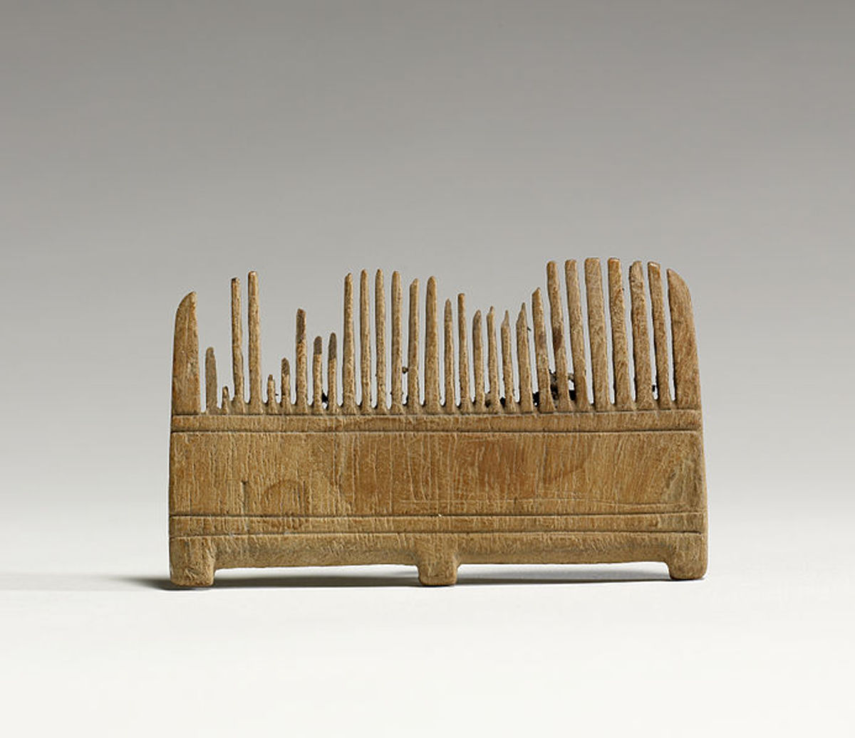 Wooden comb from the same era.