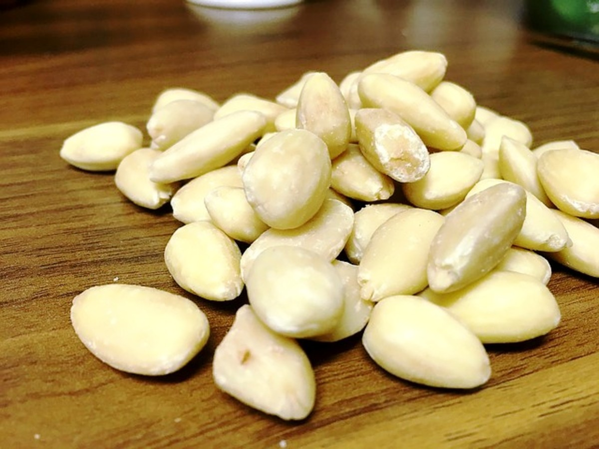 You can buy whole blanched almonds or almond meal.