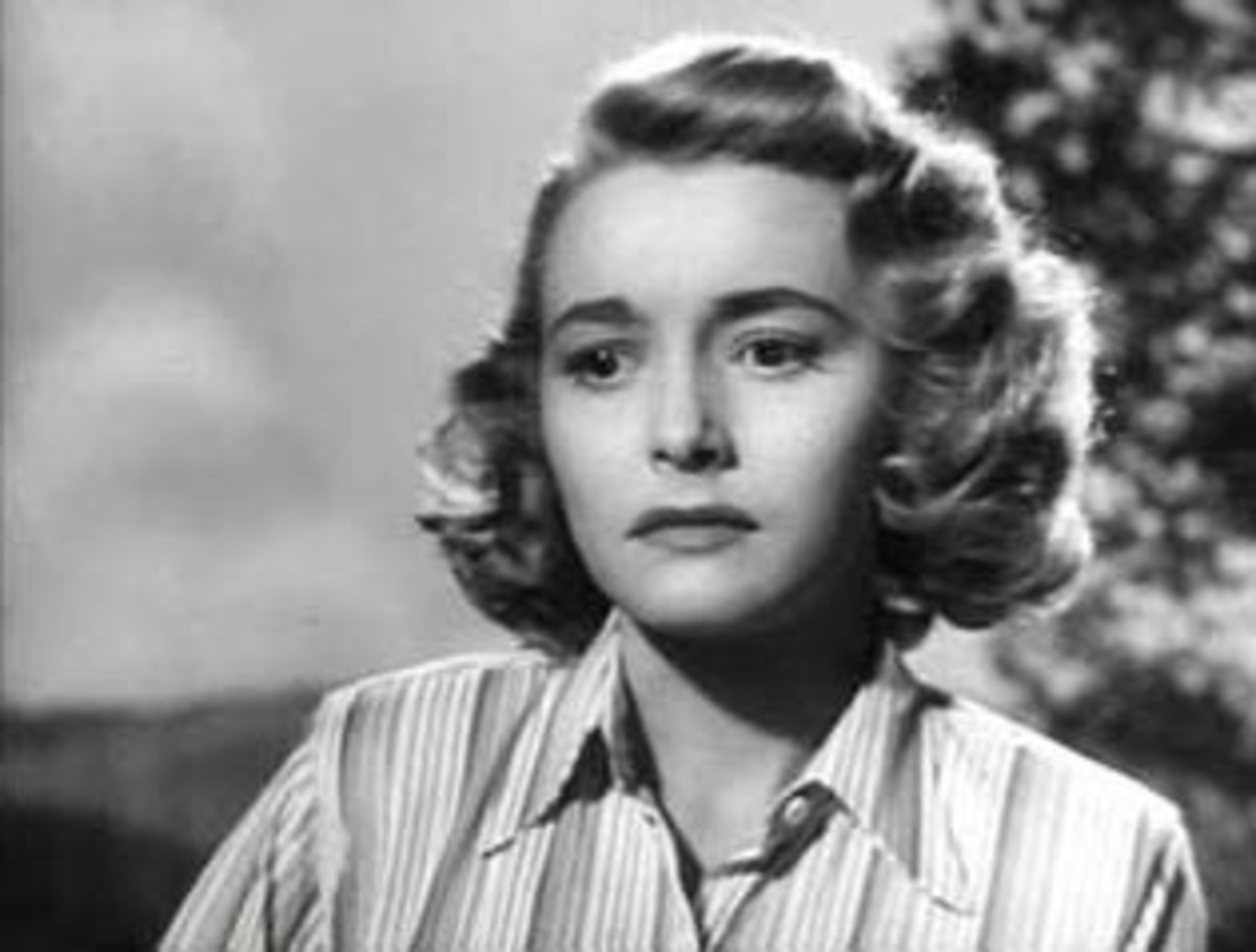 Dominique Francon (As portrayed by Patricia Neil) In the book the aesthetics of Dominique are never described.