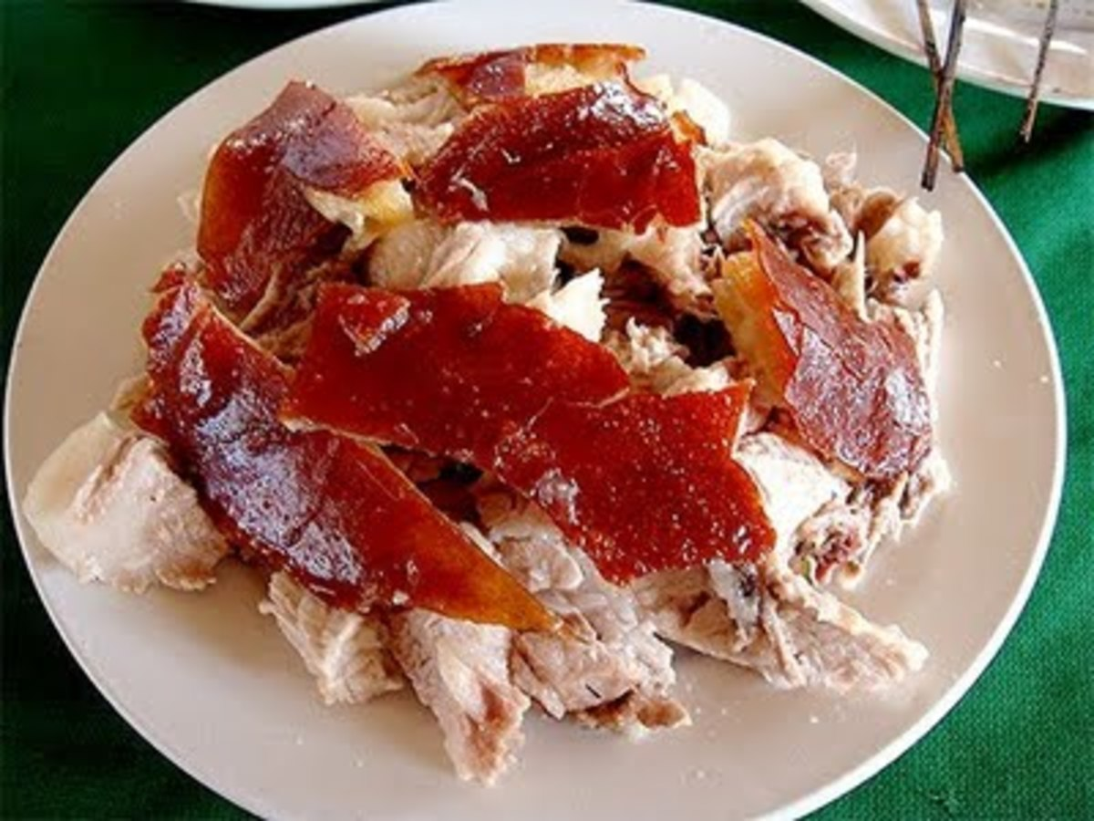 "The lechon skin or ""balat"" is best paired with  vinaigrette."