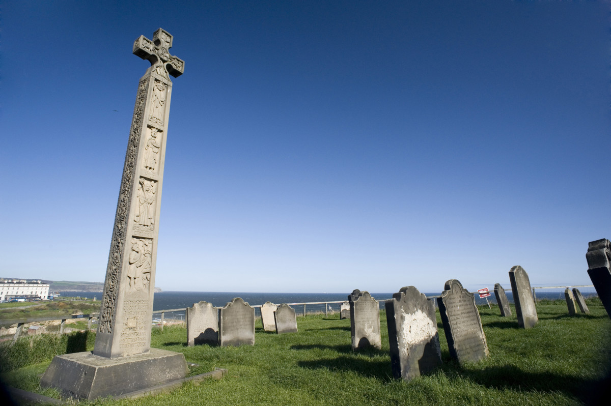 Caedmon's cross close by St Mary's Church and Whitby Abbey
