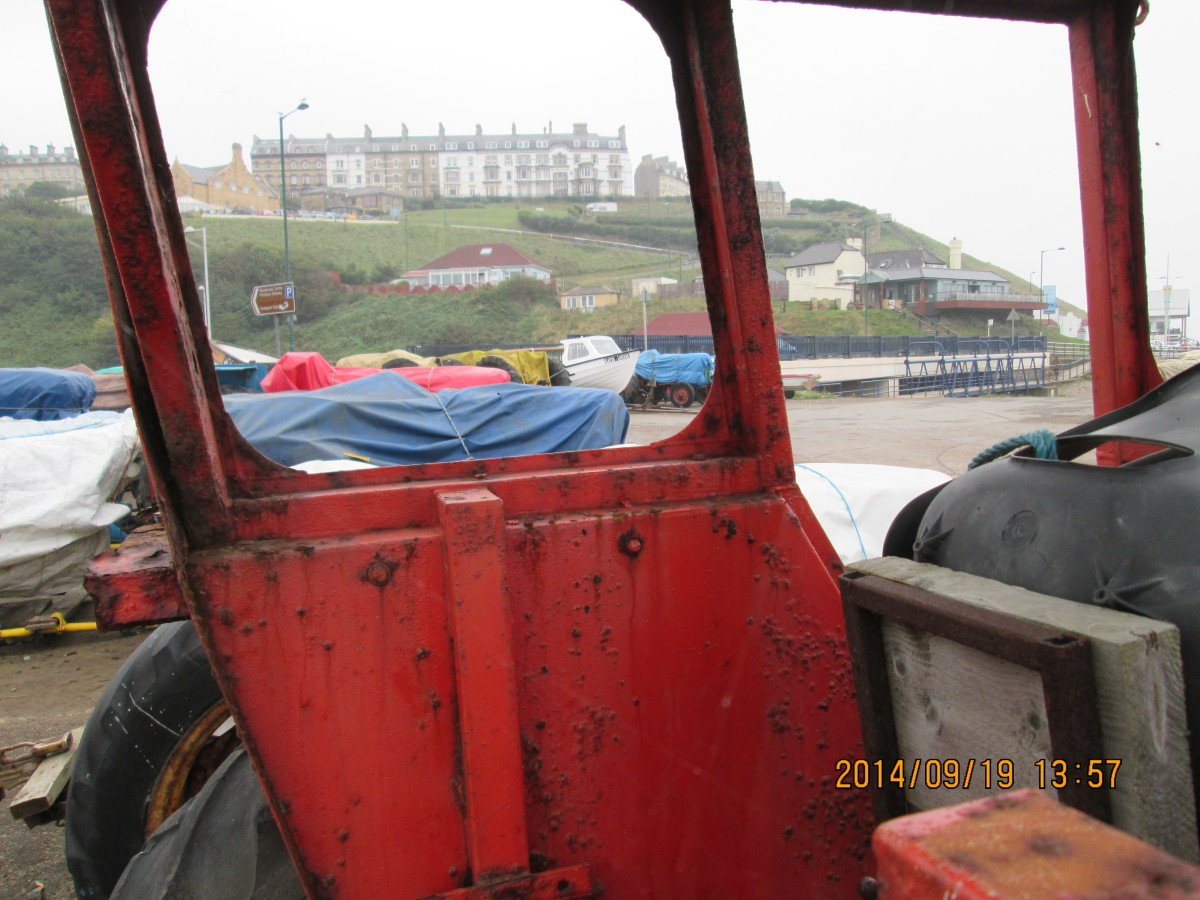 Saltburn, the Victorian S&DR town established by Edward Pease, seen through a tractor cab by Old Saltburn