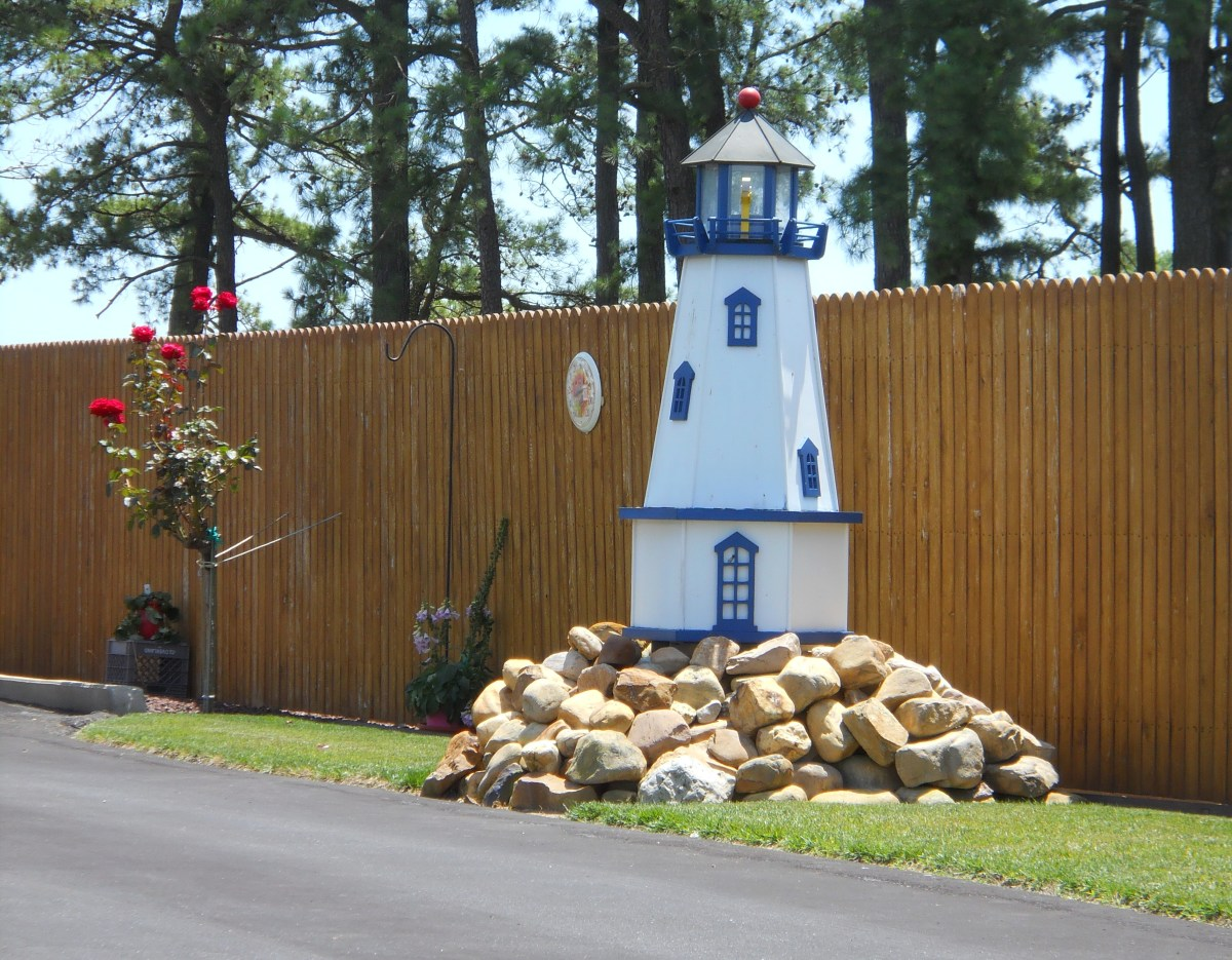 Ornamental lighthouse along driveway in Leipsic, Delaware. The house faces the Leipsic River and this ornament suits its location.