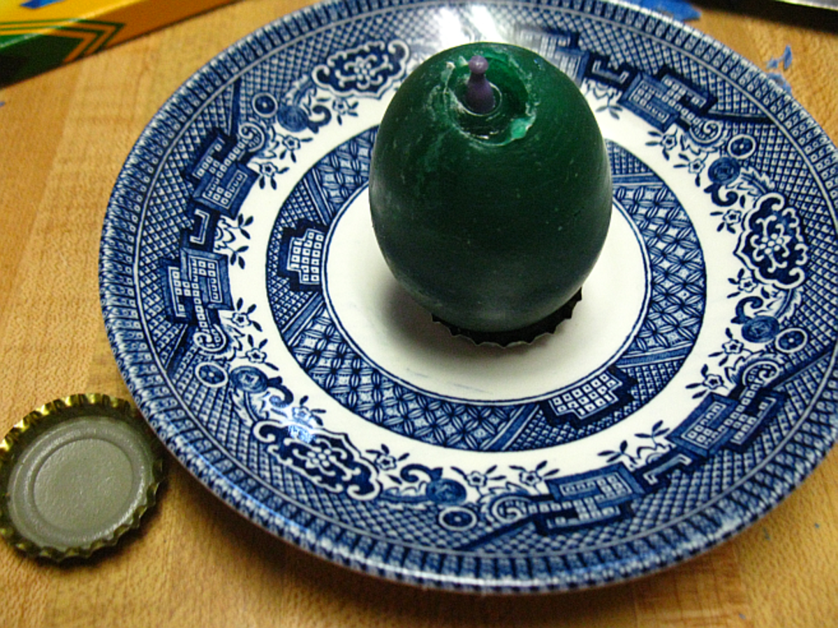 another way to stand your candle up securely is to put it in a bottle cap