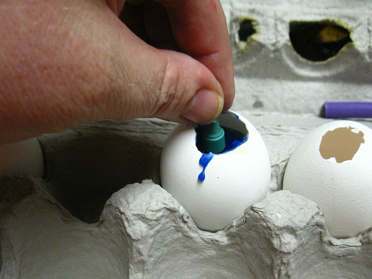 insert birthday candle into wax in shell while wax is still soft