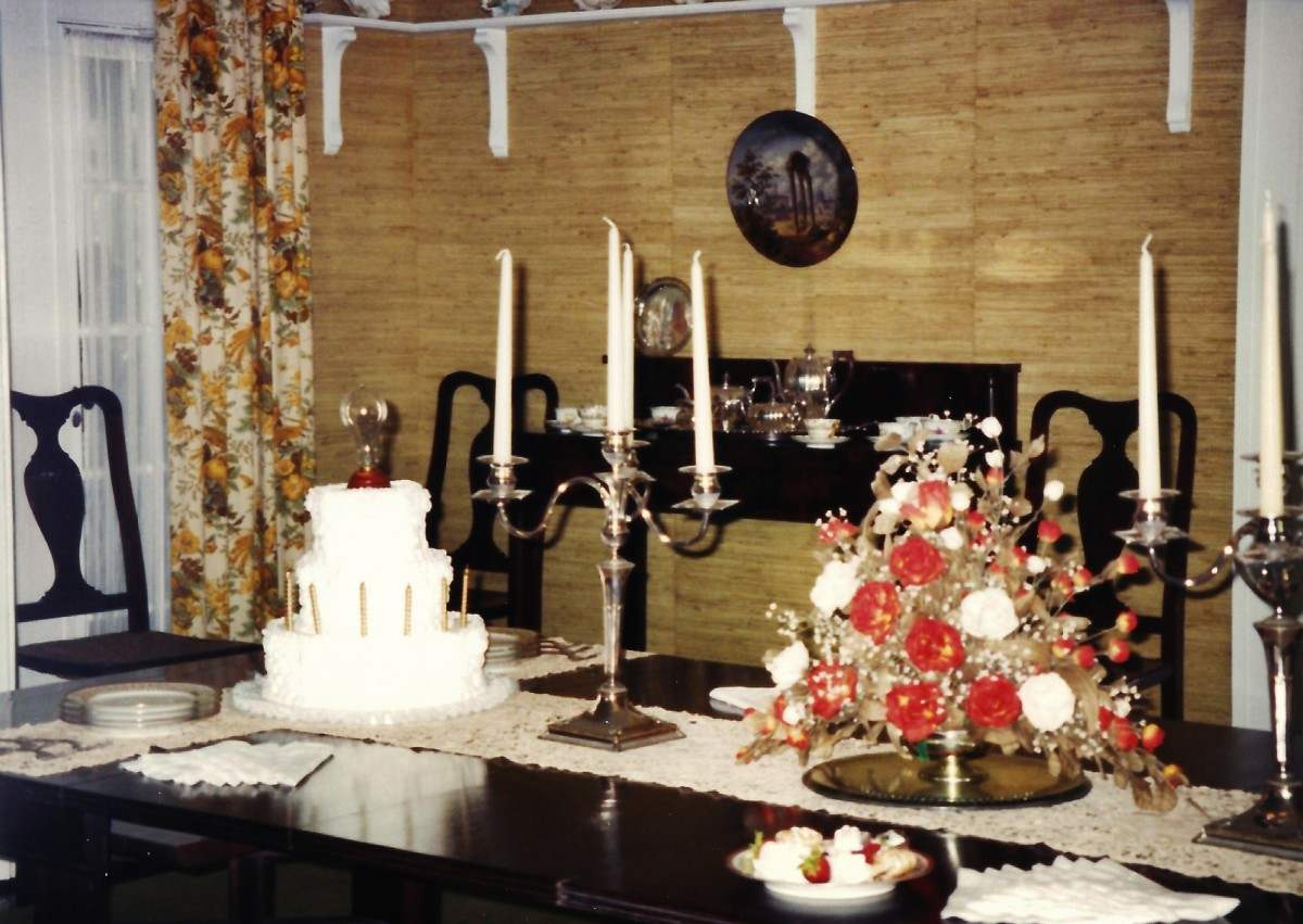 Note the cake with lightbulb on the Edison dining table.