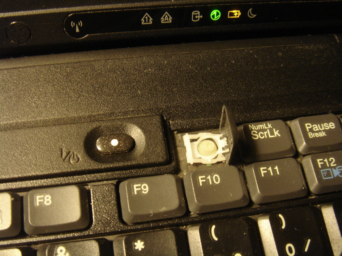 Broken key before replacement by a 'near new' keyboard.