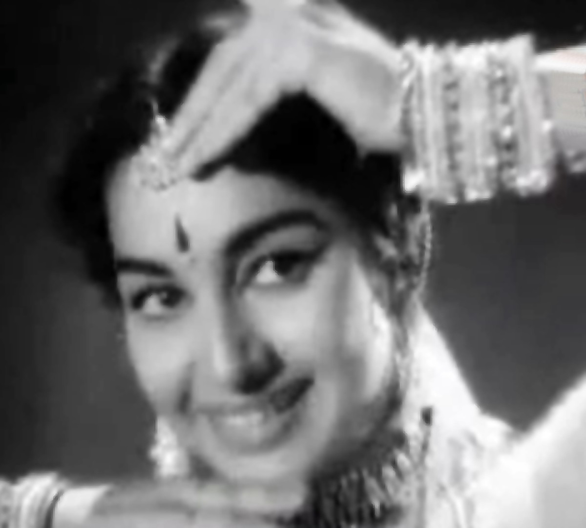 A great number from Mohammed Rafi, based on Raga Bhairavi, featured in the movie on Ashok Kumar (as an ugly singer trying to hide his face by dim lighting) and a scintillating dance performance by Asha Parekh - probably her best!
