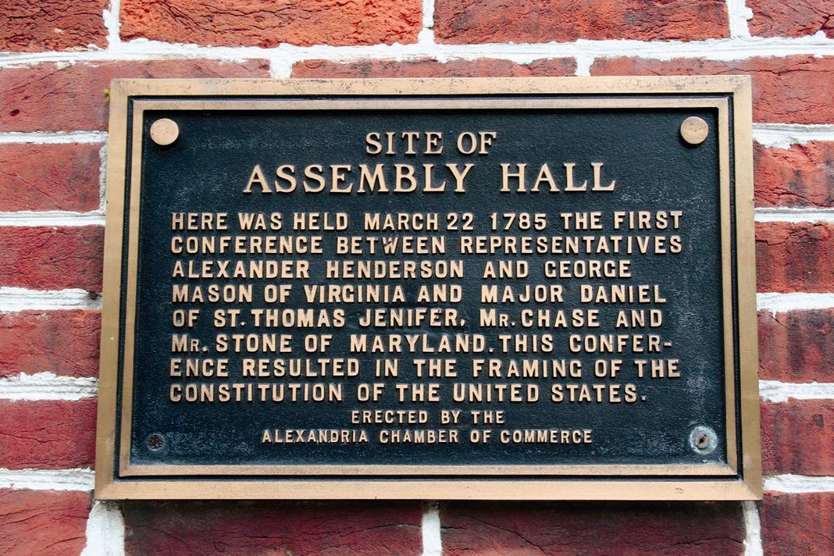 A plaque on City Hall blandly recalls a significant event here.