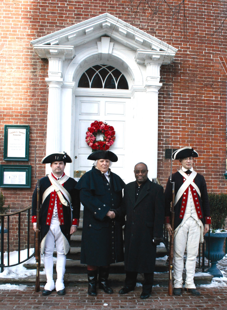 General Washington greets Mayor Bill Euille on the steps of Gadsby's.