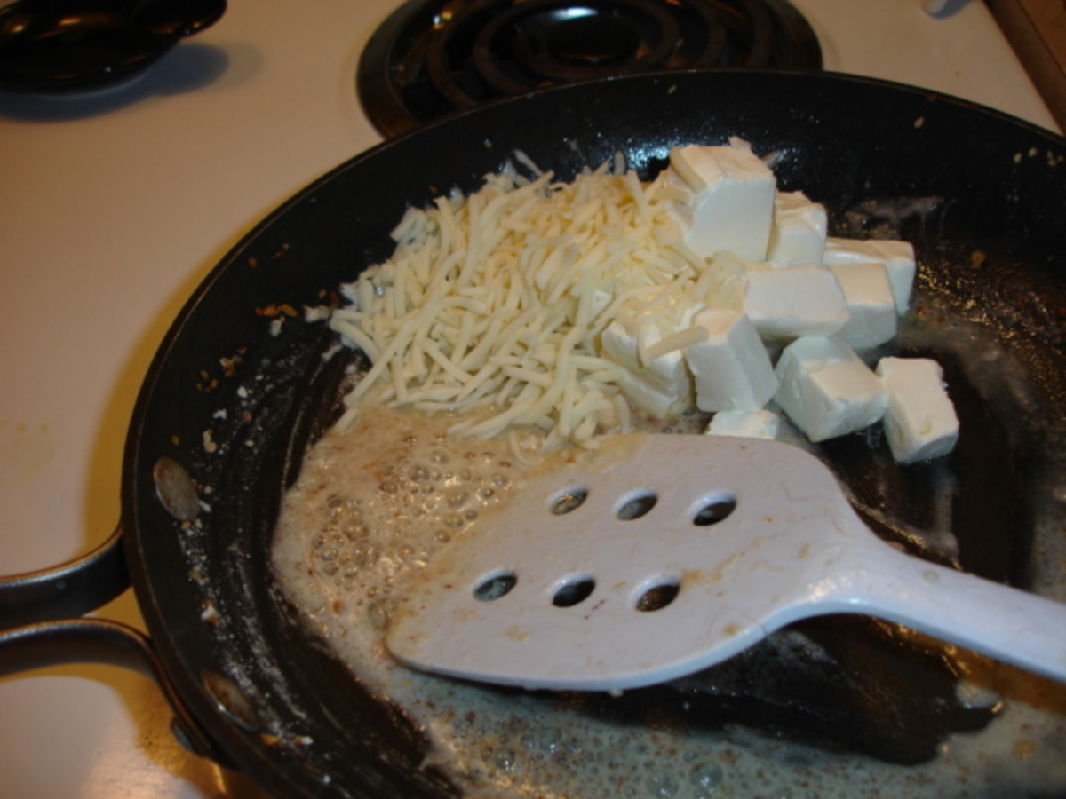 Stirring the cheeses. Pappadeaux lump crab meat spinach au gratin