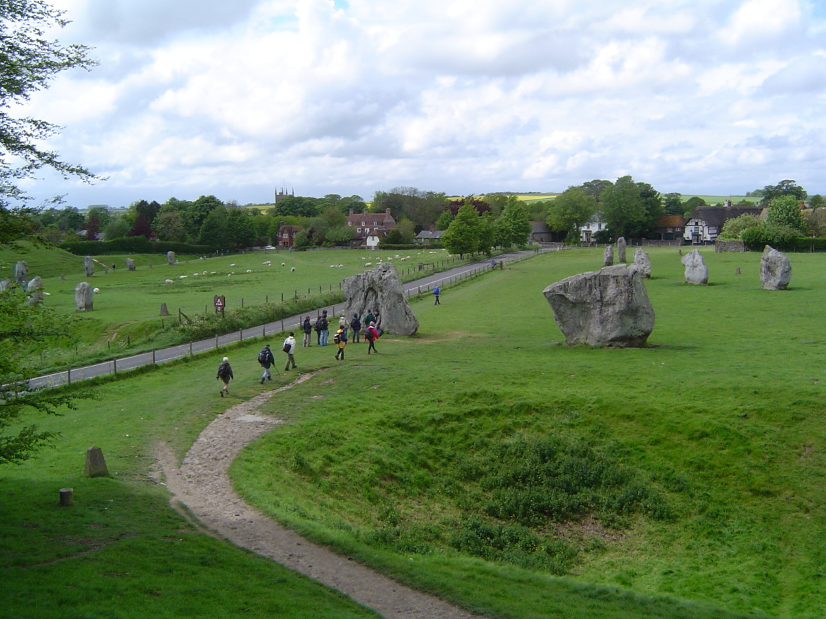 Avebury: the ditch in the right foreground circles the village of Avebury, which can be seen in the middle distance. Unlike Stonehenge, there is full and free access to the stones.