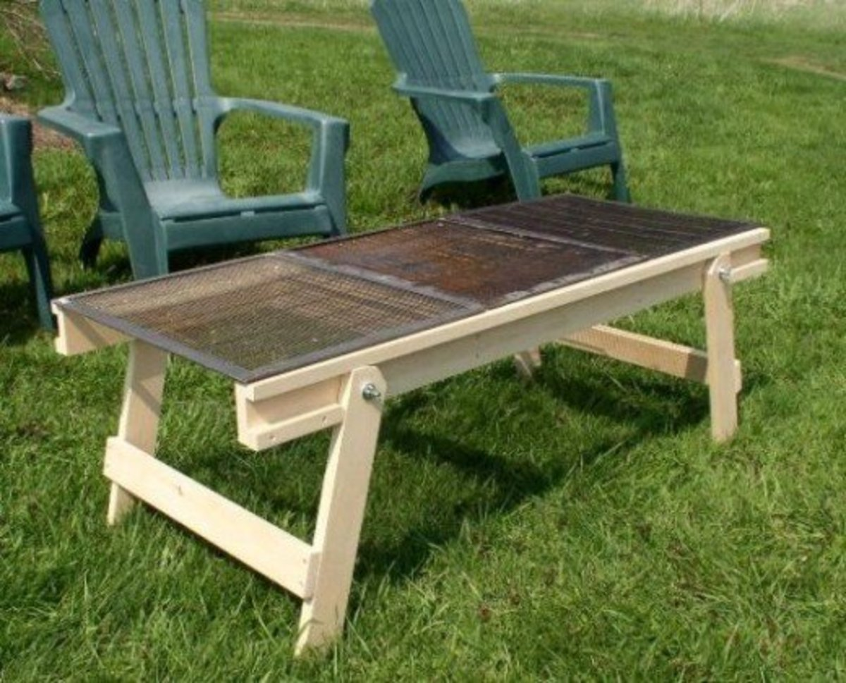 Portable beekeeping workbench with queen excluders for use as a picnic table