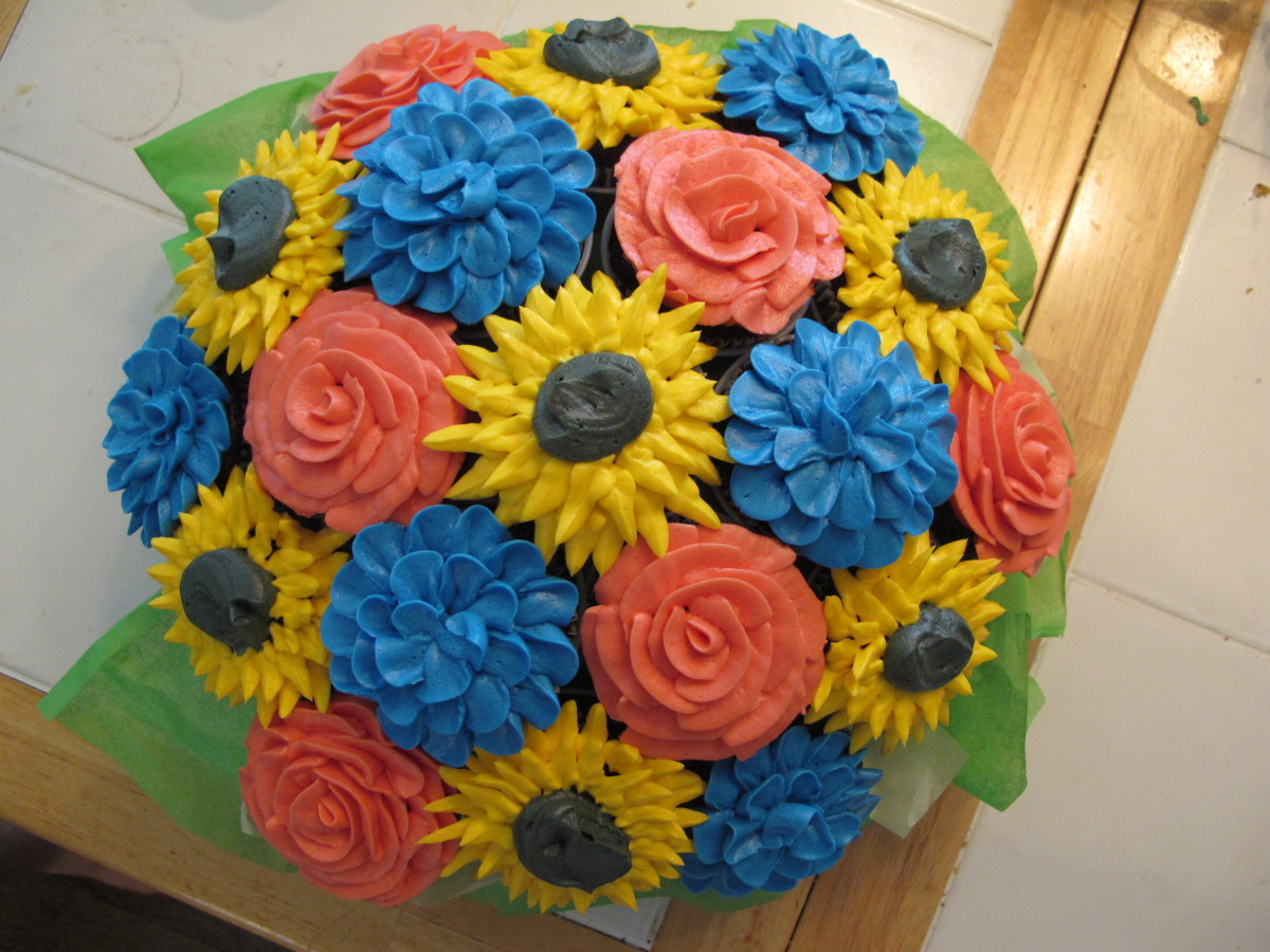 A rose, sunflower and carnation cupcake bouquet for a 6 year old's birthday