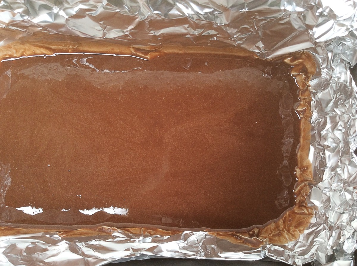 Liquid coconut oil has been added and the mixture has been poured into a loaf pan lined with aluminum foil. It's ready to go into the freezer.