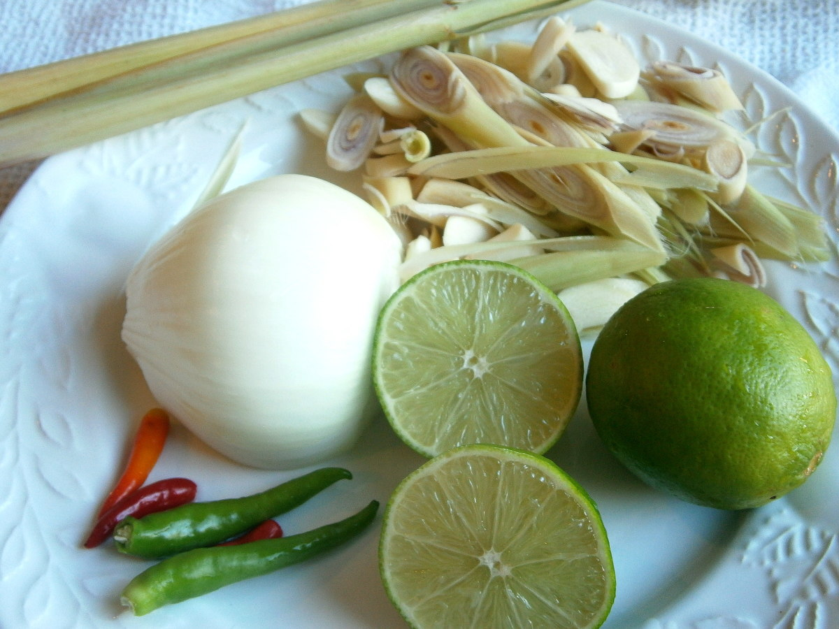 The necessary ingredients  for Tom Yum soup--Thai chilies, lemon, lemon grass, garlic , onion and kaffir leaves (shown in the next picture).