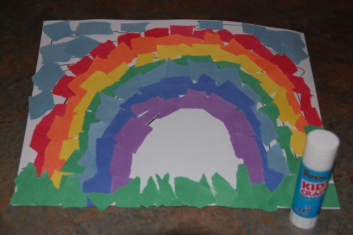 Rainbow collage from torn construction paper