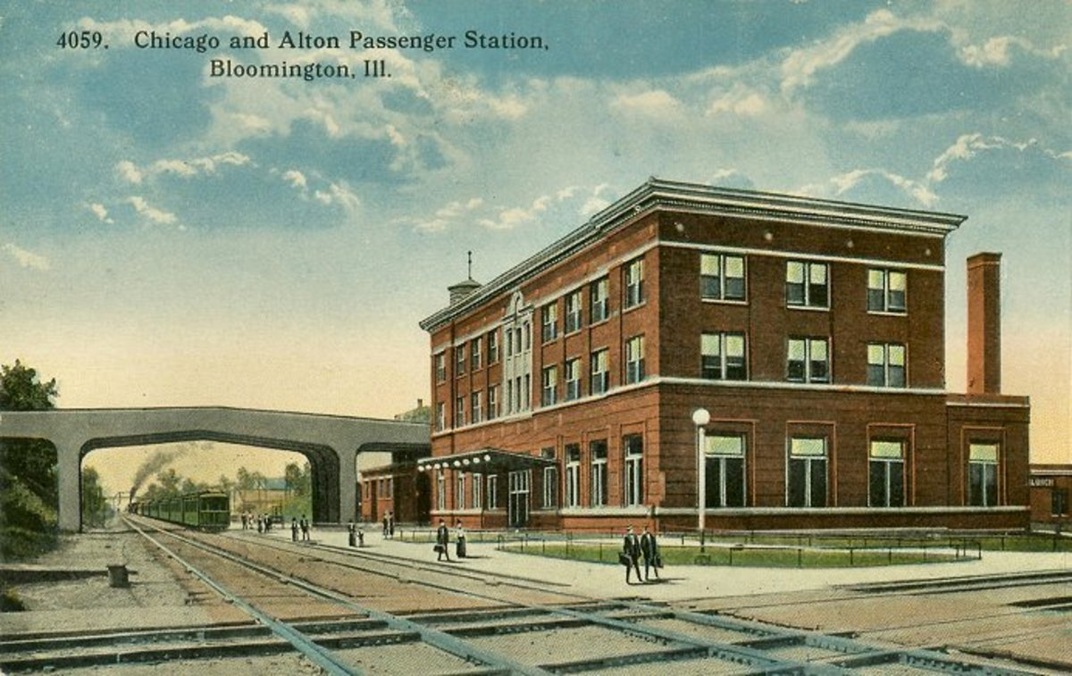 Postcard of Bloomington, Illinois passenger rail station, circa 1925.  This station served the area from the early 20th Century through 1991.  Many other photos of the building are available at RailPictures.net