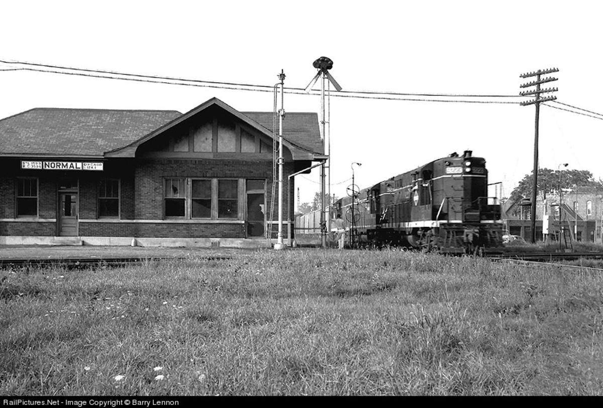 The Normal, Illinois station at the crossing of the Illinois Central and Gulf, Moble & Ohio lines, as pictured on September 15, 1963.  This station was demolished in the 1970s.