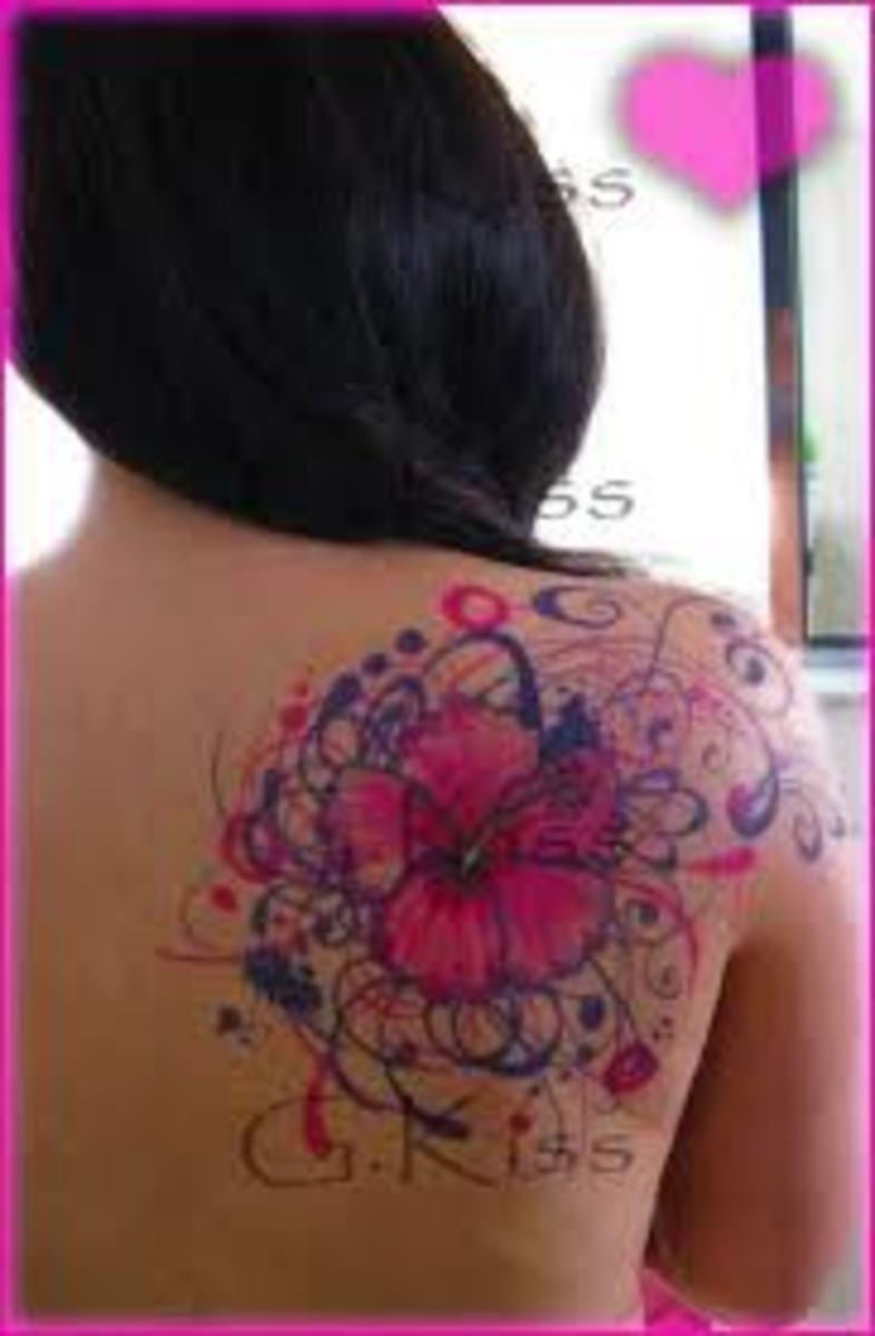 Beautiful hibiscus tattoo design with artistic details surrounding the hibiscus.