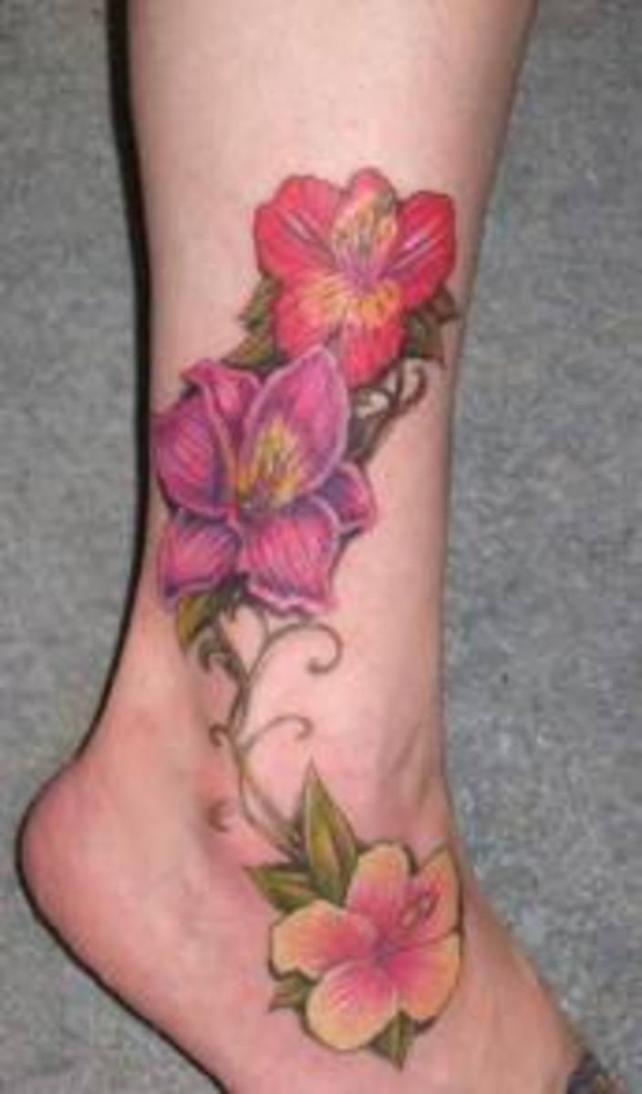 Hawaiian Flower Tattoos On Foot