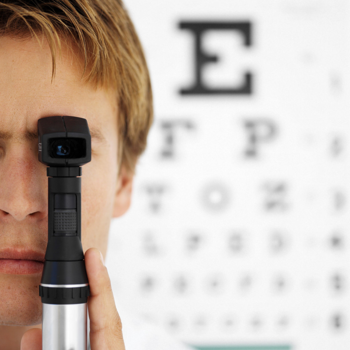 An optometrist uses an ophthalmoscope.