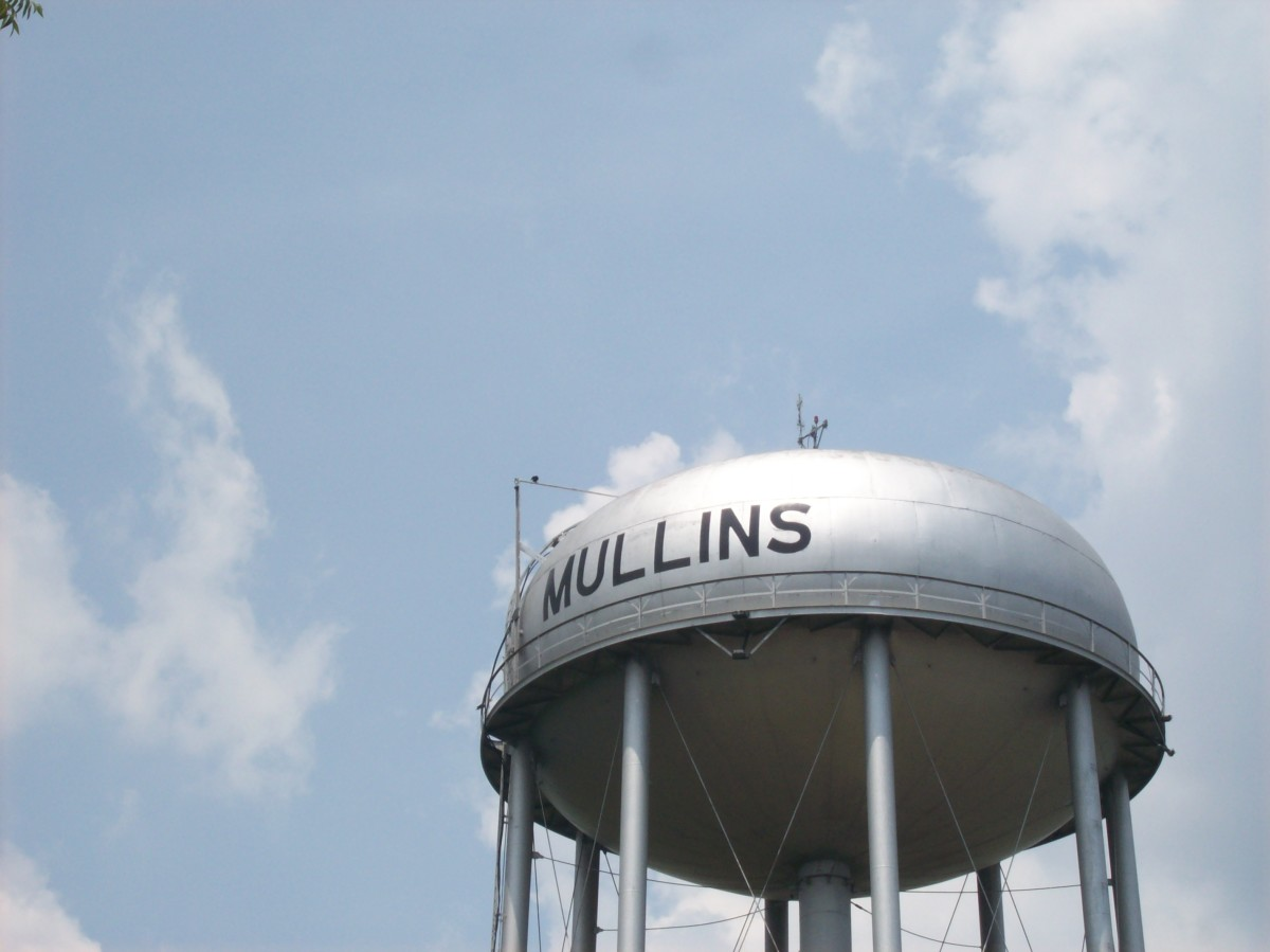 This water tower continues to exist today in the middle of our small hometown Mullins, South Carolina. This tower has been a symbol within our hometown for decades.