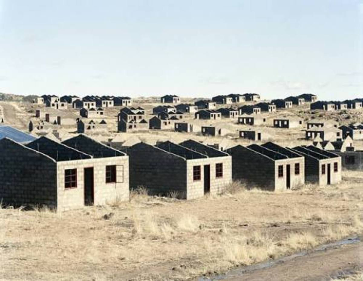 Unfinished housing stuck from those who own tenders not completing the job the money they have is allocated for