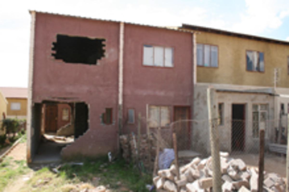 Some of the houses have been vandalized by members of the community