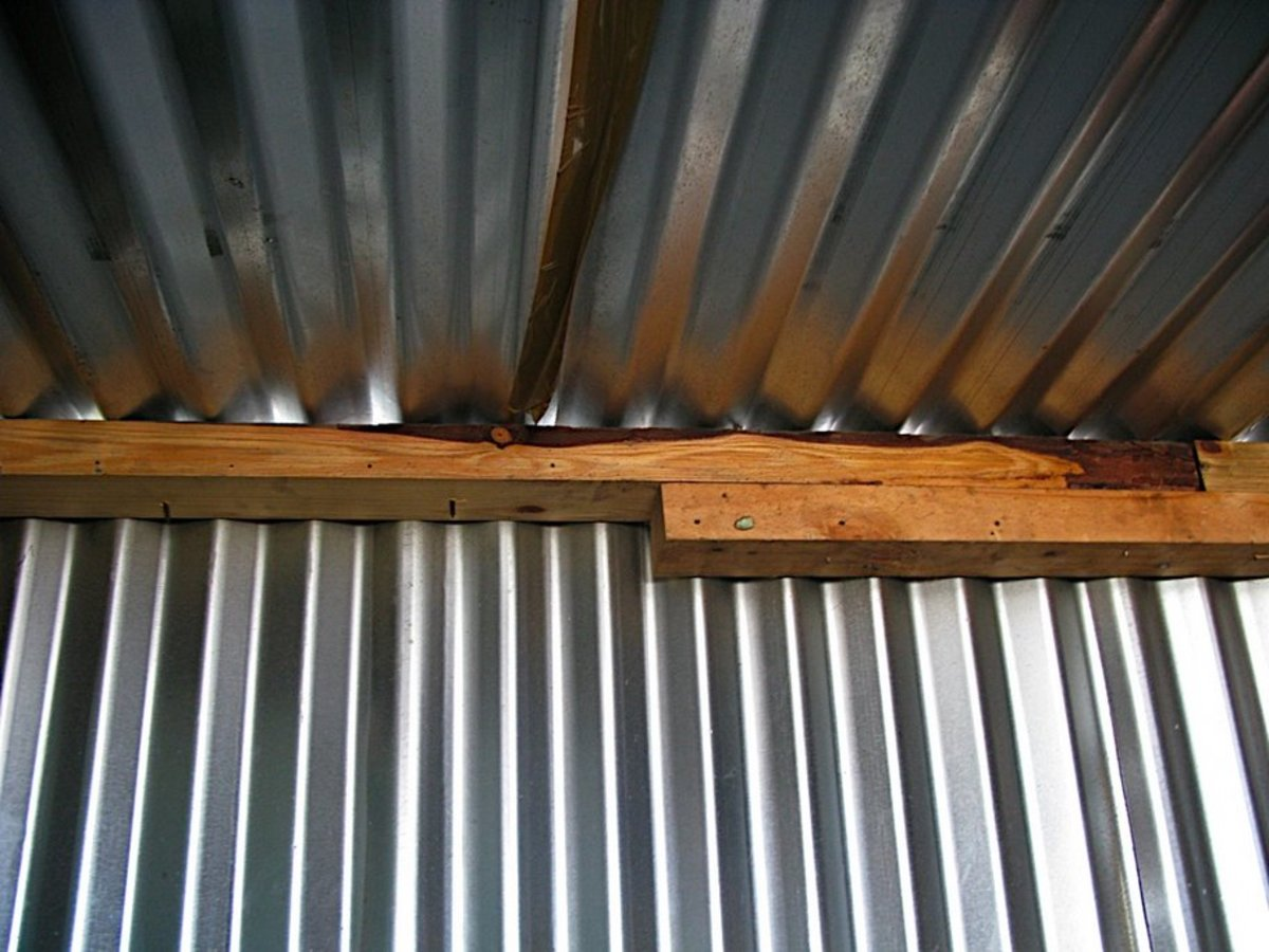 The shoddy corrugated ceiling with half-cut planks for support