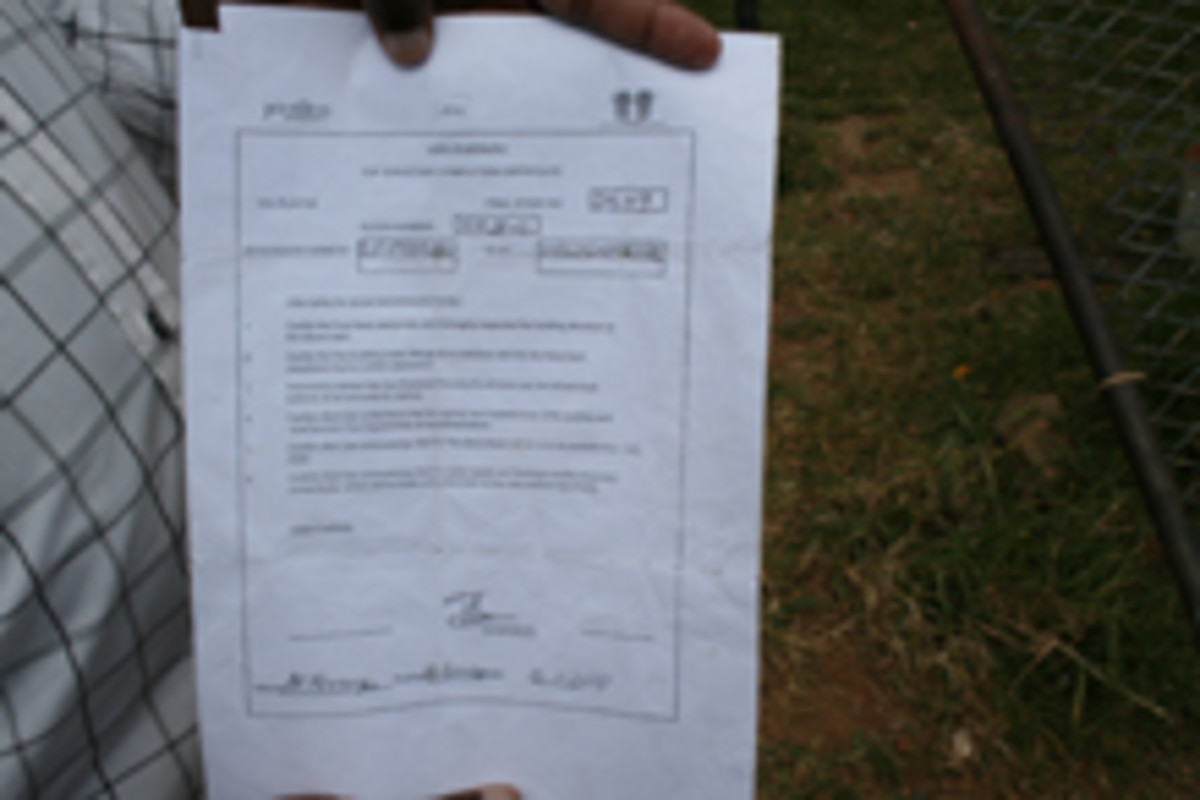 "Sobongiseni Ngcobo show Corruption Watch the ""happy letter"" he signed confirming the number 2549 is his house - but someone else is living in it"